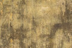 Yellow gray white old wall with scratches, mold stains, cracks and peeling paint. rough surface texture stock photo