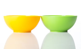 Yellow and greel plastic snack bowls. Yellow and green plastic snack bowls on white background Stock Photo