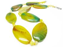 Yellow and green agate beads Stock Images