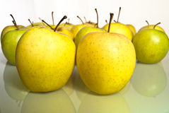 Yellow green apples with reflection Royalty Free Stock Images