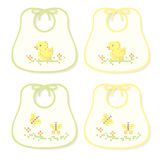 Yellow and green Baby bibs. Embroidered bibs for boys and girls Royalty Free Stock Images