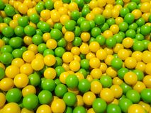 Yellow and green ball pool, children`s playground royalty free stock image