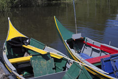Yellow and green Bateira boats Stock Image