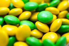 Yellow And Green Bean Shaped Confectionery Closeup Stock Photography