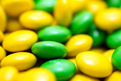 Yellow And Green Bean Shaped Confectionery Macro Stock Photography