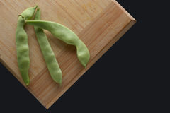 Yellow and green beans on a cutting board. Royalty Free Stock Photo