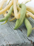 Yellow and green beans. Raw vegetables on the table Stock Photo