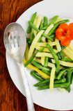 Yellow and green beans side dish. Healthy side of colorful vegetables smothered in lemon juice and zest that could be served warm or cold with a vibrant edible Royalty Free Stock Image