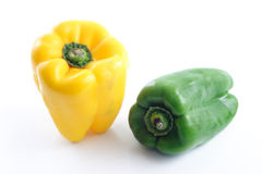 Yellow and green bell peppers Stock Images