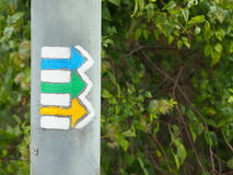 Yellow, green and blue tourist arrows Stock Image