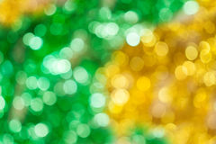 Yellow and green bokeh Stock Images