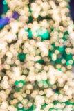 Yellow, green bokeh lights of Christmas lights Stock Image