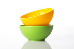 Yellow and green bowls. Stacked one above the other on white background Stock Images