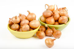 Two bowls full of onions on a white background Stock Photography