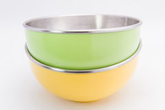 Yellow and green bowls stacked Stock Image