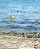Yellow and green buoys Stock Photography