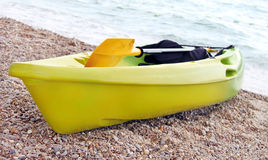 Yellow and green canoe. At Black sea, Ukraine Royalty Free Stock Image
