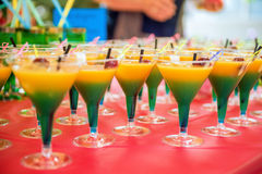 Yellow green cocktail with cherry royalty free stock image