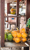 Yellow and Green Coconuts in a Market. Fresh yellow and green coconuts for sale in an outdoor market Royalty Free Stock Photo