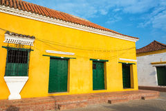 Yellow and Green Colonial Architecture Royalty Free Stock Photography