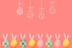Yellow and green colored easter eggs on the blue wooden background. free space for text stock image