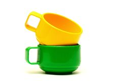 Yellow and green cups Royalty Free Stock Photography