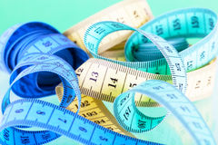 Yellow, green and dark blue measuring tapes Royalty Free Stock Image