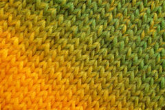 Yellow and green diagonal stockinette stitch background Stock Images