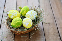Yellow-green Easter eggs Stock Images