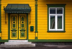 Yellow and green facade in Pärnu, the fourth largest city in Estonia. Norther Europe stock image