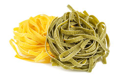 Yellow and green fettuccine Stock Images