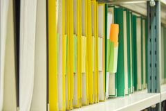 Yellow and green file folders in archive Stock Photo