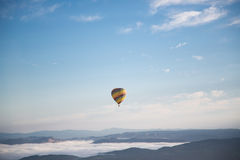 Yellow and Green Hot Air Balloon Floating on Mid Air Under Blue and White Sunny Cloud Sky Royalty Free Stock Image