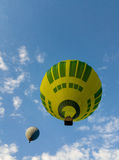 Yellow green hot air balloon. Yellow green and light blues hot air balloons stock images