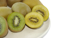 Yellow  and green kiwi fruits Stock Images