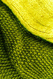 Yellow and green Knitted wool fabric texture background close up Stock Image