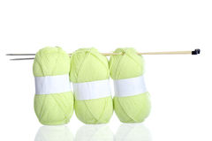 Yellow green knitting yarn with needles Royalty Free Stock Images