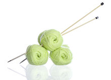 Yellow green knitting yarn with needles Stock Photos