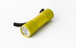 Yellow-green led aluminum flashlight on a white background Stock Image