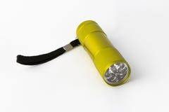 Yellow-green led aluminum flashlight on a white background Royalty Free Stock Photos