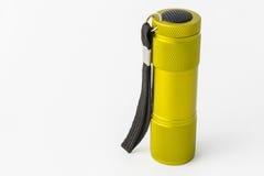 Yellow-green led aluminum flashlight on a white background Royalty Free Stock Photography