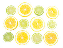 Yellow and green lemon and lime slices on white background Royalty Free Stock Images