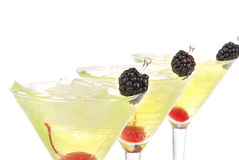 Yellow green martini cocktails row Royalty Free Stock Photography