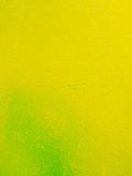 Yellow green metal texture with a roughness and drops of paint surface. Grunge urban background Stock Photos