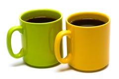 Yellow and green mug Stock Image