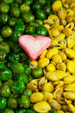 Yellow and green nut with pink marshmallow. Make shot Royalty Free Stock Photography