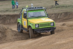 Yellow and green off road car in terrain Royalty Free Stock Photography