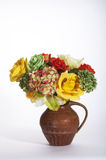 Yellow, Green, and Orange Roses and Hydrangia in a Brown Jug Royalty Free Stock Photos