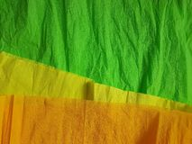 Green yellow paper background silk surface empty blank sheets vivid colors. Yellow green paper background silk surface empty blank sheets vivid colors wrapping Stock Photography