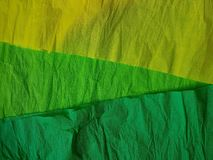 Yellow green paper background silk surface empty blank sheets vivid colors. Wrapping Royalty Free Stock Photos